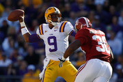 Jordan Jefferson #9 of the Louisiana State University Tigers throws under pressure from Dont'a Hightower #30 of the Alabama Crimson Tide  at Tiger Stadium on November 6, 2010 in Baton Rouge, Louisiana.