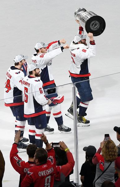 2018 NHL Stanley Cup Final - Game Five [ice hockey,hockey,college ice hockey,stick and ball games,team sport,sports gear,sports,player,ice hockey equipment,tournament,alex ovechkin,teammates,five,rink,l-r,nhl,washington capitals,stanley cup final,game,nhl stanley cup final]