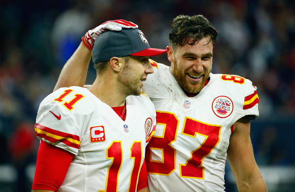 Wild Card Round - Kansas City Chiefs v Houston Texans [player,sports,team sport,ball game,football player,product,facial expression,fan,facial hair,sports equipment,alex smith,travis kelce 87,spencer ware,wild card,nrg stadium,houston,houston texans,kansas city chiefs,round,touchdown]