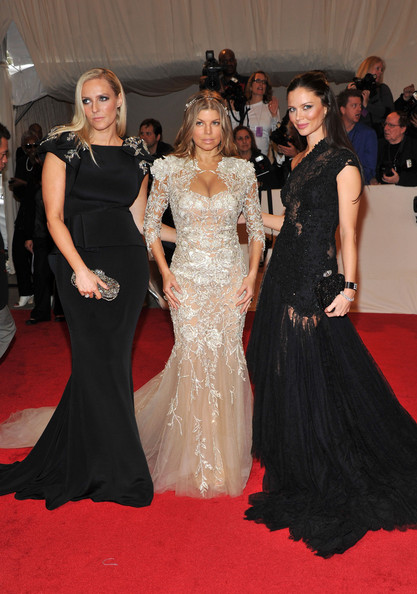 "Designers Keren Craig (L) and Georgina Chapman (R) of Marchesa with Fergie attend the ""Alexander McQueen: Savage Beauty"" Costume Institute Gala at The Metropolitan Museum of Art on May 2, 2011 in New York City."