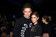 Eddie Redmayne (L) and Kate Mara attend the Alexander Wang X H&M Launch on October 16, 2014 in New York City.