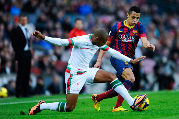 Alexis Sanchez Alexis Sanchez of FC Barcelona duels for the ball with Brahimi of Granda CF during the La Liga match between FC Barcelona and Granda CF at Camp Nou on November 23, 2013 in Barcelona, Spain.