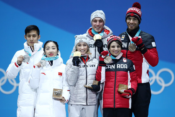 Medal Ceremony - Winter Olympics Day 6 [silver medal,medal,team,sports,championship,recreation,award,individual sports,medalists,bronze medalists,cong han,wenjing sui,l-r,gold medalists,china,medal ceremony,winter olympics,medal ceremony]