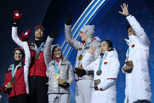 Medal Ceremony - Winter Olympics Day 6 [event,performance,championship,competition,world,team,competition event,uniform,gesture,space,medalists,silver medalists,eric radford,meagan duhamel,l-r,gold medalists,canada,medal ceremony,winter olympics,medal ceremony]