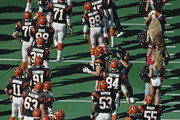 Boomer Esiason #7, Quarterback for the Cincinnati Bengals is greeted by the whole team before the start of the American Football Conference Central game against the Indianapolis Colts on 22 October 1989 at the Riverfront Stadium, Cincinnati, Ohio United States. The Colts won the game 23 - 12.