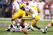 Jordan Jefferson #9 of the Louisiana State University Tigers loses the ball in the first quarter against the Alabama Crimson Tide during the 2012 Allstate BCS National Championship Game at Mercedes-Benz Superdome on January 9, 2012 in New Orleans, Louisiana.