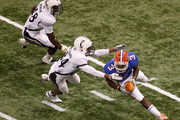 Chris Rainey #3 of the Florida Gators is tackled by Orion Woodard #84 and Maalik Bomar #48during the Allstate Sugar Bowl at the Louisana Superdome on January 1, 2010 in New Orleans, Louisiana.