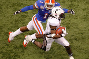 Mardy Gilyard #1 of the Cincinnati Bearcats is tackled by Janoris Jenkins #1 of the Florida Gators during the Allstate Sugar Bowl at the Louisana Superdome on January 1, 2010 in New Orleans, Louisiana.