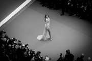 """Image has been converted to black and white) Romee Strijd arrives for the opening ceremony and screening of """"The Dead Don't Die"""" during the 72nd annual Cannes Film Festival on May 14, 2019 in Cannes, France."""