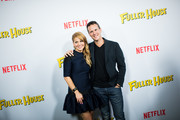 Actors Candace Cameron-Bure (L) and Scott Weinger attend the premiere of Netflix's 'Fuller House' at Pacific Theatres at Pacific Theatres at The Grove on February 16, 2016 in Los Angeles, California.
