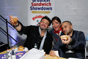 (L-R) Adam Richman, Kathy Wakile and Founder & CEO of Goldbelly, Joe Ariel attend America's Greatest Sandwich Showdown during New York City Wine & Food Festival at Highline Stages on October 13, 2019 in New York City.