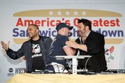 """(L-R) Founder & CEO of Goldbelly, Joe Ariel, Nick Gordon and Manny Loizos celebrate the winning sandwich """"The Bomb"""" by Sal, Kris and Charlie's Deli at America's Greatest Sandwich Showdown during New York City Wine & Food Festival at Highline Stages on October 13, 2019 in New York City."""