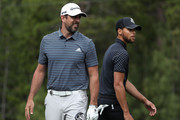 NFL athlete Aaron Rodgers of the Green Bay Packers watches his tee shot on the 18th hole alongside NBA athlete Stephen Curry of the Golden State Warriors during round one of the American Century Championship at Edgewood Tahoe South golf course on July 10, 2020 in Lake Tahoe, Nevada.