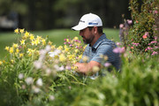 NFL athlete Aaron Rodgers of the Green Bay Packers sits near the 18th tee box during round one of the American Century Championship at Edgewood Tahoe South golf course on July 10, 2020 in Lake Tahoe, Nevada.