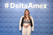 Actress Elizabeth Olsen poses during the American Express and Delta Air Lines #DeltaAmex Card Relaunch event at 14th Street Garage on October 02, 2019 in New York City.