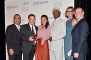 (L-R) Executive Director American Fertility Association Ken Mosesian, Jeffrey Arden Bernstein, actors Margot Robbie, Samuel L. Jackson and Brenda Strong and EMD Serono's Don Hribek attend the American Fertility Association's Illuminations LA at W Hollywood on May 3, 2014 in Hollywood, California.