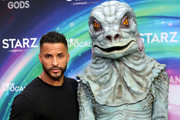 Ricky Whittle poses with an alien at the American Gods & Now Apocalypse Live Viewing Party At #TwitterHouse at Lustre Pearl on March 10, 2019 in Austin, Texas.