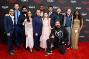 (L-R) Omid Abtahi, Pablo Schreiber, Mousa Kraish, Sakina Jaffrey, Ian McShane, Demore Barnes, Emily Browning, Ricky Whittle, Peter Stormare, Crispin Glover, Bruce Langley, and Yetide Badaki attend the American Gods Season Two Red Carpet Premiere Event on March 5, 2019 in Los Angeles, California.