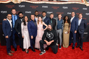 (L-R) Omid Abtahi, Pablo Schreiber, Mousa Kraish, Sakina Jaffrey, Ian McShane, Demore Barnes, Emily Browning, Ricky Whittle, Peter Stormare, Crispin Glover, Bruce Langley, Yetide Badaki, Carmi Zlotnik and Jeffrey Hirsch attend the American Gods Season Two Red Carpet Premiere Event on March 5, 2019 in Los Angeles, California.