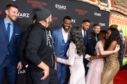 Pablo Schreiber, Mousa Kraish, Sakina Jaffrey, Ian McShane, Demore Barnes, Emily Browning, Ricky Whittle, Peter Stormare, Crispin Glover, Bruce Langley and Yetide Badaki attend the American Gods Season Two Red Carpet Premiere Event on March 5, 2019 in Los Angeles, California.