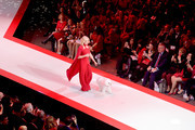 Bo Derek and Flynn walk the runway for The American Heart Association's Go Red For Women Red Dress Collection 2019 Presented By Macy's at Hammerstein Ballroom on February 7, 2019 in New York City.