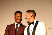 "Nate Parker and Theo Rossi walks the red carpet ahead of the ""American Skin"" screening during the 76th Venice Film Festival at Sala Giardino on September 01, 2019 in Venice, Italy."