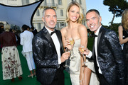 Dan Caten, Hailey Clauson and Dean Caten attend the cocktail at the amfAR Gala Cannes 2018 at Hotel du Cap-Eden-Roc on May 17, 2018 in Cap d'Antibes, France.