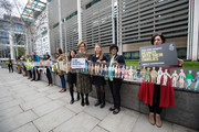 British actress Juliet Stevenson (C) is joined by activists as they hold up a giant paper chain during a demonstration in front of the Home Office on March 30, 2017 in London, England. Amnesty International and the Student Action for Refugees presented a 31,000 signature petition asking the UK government to stop separating child refugees from their families. The UK along with Denmark are the only European Countries that do this.