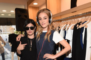 DJ Camila Grey (L) and Elizabeth Gilpin attend the Amour Vert x Swith Boutique celebration at Switch Boutique on March 26, 2015 in Beverly Hills, California.