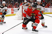Tommy Wingels #57 of the Chicago Blackhawks tries to control the puck in front of Hampus Lindholm #47 of the Anaheim Ducks.at the United Center on February 15, 2018 in Chicago, Illinois. The Ducks defeated the Blackhawks 3-2.