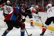 Simon Despres #24 of the Anaheim Ducks passes the puck to Cam Fowler #4 of the Anaheim Ducks against the Colorado Avalanche at Pepsi Center on March 9, 2016 in Denver, Colorado. The Avalanche defeated the Ducks 3-0.