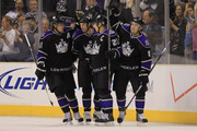 (L-R) Anze Kopitar #11, Ryan Smyth #94, Dustin Brown #23 and Drew Doughty #8 of the Los Angeles Kings celebrate Smyth's first period goal against the Anaheim Ducks at Staples Center on September 28, 2010 in Los Angeles, California.