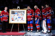 Former Montreal Canadien player Saku Koivu poses for a photo with family former teammates  during a ceremony honouring the former team captain prior to the NHL game between the Montreal Canadiens and the Anaheim Ducks  at the Bell Centre on December 18, 2014 in Montreal, Quebec, Canada.