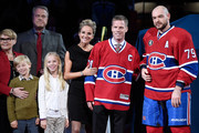 Former Montreal Canadien player Saku Koivu poses for a photo with family and former teammates  during a ceremony honouring the former team captain prior to the NHL game between the Montreal Canadiens and the Anaheim Ducks  at the Bell Centre on December 18, 2014 in Montreal, Quebec, Canada.