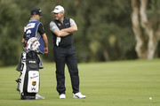 Lee Westwood of England and his Son and Caddy Sam Westwood look on before playing on the 4th hole during the completion of the weather affected second round of the Andalucia Valderrama Masters at Real Club Valderrama on October 20, 2018 in Cadiz, Spain.