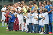 Andrea Pirlo (C) greets his teammates prior to Andrea Pirlo Farewell Match at Stadio Giuseppe Meazza on May 21, 2018 in Milan, Italy.