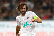Andrea Pirlo kicks the ball during Andrea Pirlo Farewell Match at Stadio Giuseppe Meazza on May 21, 2018 in Milan, Italy.