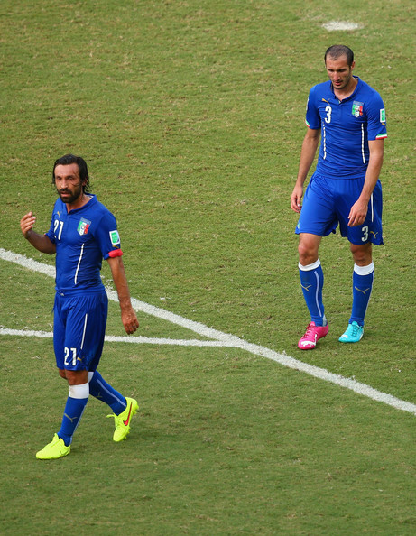 Italy v Uruguay: Group D  [player,sports,sports equipment,soccer player,team sport,sport venue,ball game,football player,soccer,football,andrea pirlo,giorgio chiellini,italy,estadio das dunas,brazil,natal,uruguay: group d,l,2014 fifa world cup brazil group d,match]