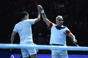 Mansour Bahrami and Tim Henman celebrate a point against Andy Murray and Jamie Murray during Andy Murray Live at The Hydro on November 7, 2017 in Glasgow, Scotland.