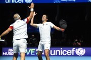 "Iran's Mansour Bahrami high fives with Britain's Tim Henman (R) during their exhibition doubles match against Britain's Andy Murray and Britain's Jamie Murray at ""Andy Murray Live"" at the SSE Hydro in Glasgow, Scotland on November 7, 2017. .""Andy Murray Live"" is a charity fundraiser. Glasgow based charity, Sunny-sid3up, join Unicef as charity partner this year. / AFP PHOTO / Andy BUCHANAN"
