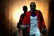 Mansour Bahrami and partner Tim Henman make their way out onto the court during Andy Murray Live at The Hydro on November 7, 2017 in Glasgow, Scotland.