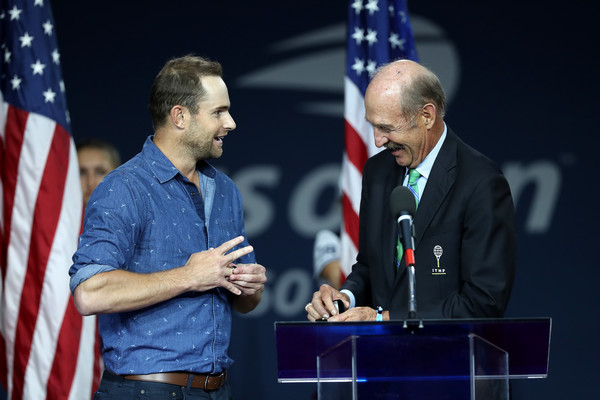 2018 US Open - Day 12 [speech,event,spokesperson,joint,official,public speaking,technology,orator,job,world,andy roddick,men,stan smith,day twelve,neighborhood,international tennis hall of fame,us open,inductee ring,ring presentation ceremony,matches]