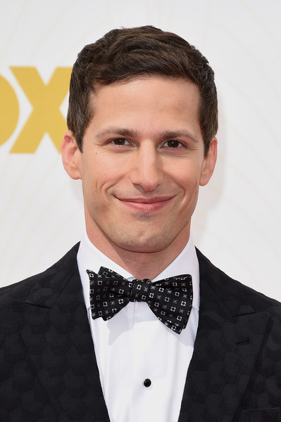 67th Annual Primetime Emmy Awards - Arrivals [hair,bow tie,suit,tie,tuxedo,hairstyle,formal wear,chin,forehead,white-collar worker,arrivals,andy samberg,microsoft theater,los angeles,california,primetime emmy awards]