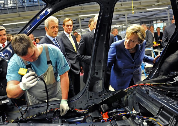 Angela Merkel German Chancellor Angela Merkel (R) inspects the car production section accompanied by Stanislaw Tillich, Governor of the State of Saxony, during a visit of the BMW auto assembly plant on November 5, 2010 in Leipzig, Germany. Later Merkel and BMW Chairman Norbert Reithofer officially inaugurated BMW's committment to invest EUR 400 million to expand production at Leipzig and to mass produce a BMW electric car.