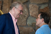 (L to R) Howard Stringer, former chief executive officer of Sony, speaks with Jonathan Nelson, founder of Providence Equity Partners, speak with each other as they attend the annual Allen & Company Sun Valley Conference, July 5, 2016 in Sun Valley, Idaho. Every July, some of the world's most wealthy and powerful businesspeople from the media, finance, technology and political spheres converge at the Sun Valley Resort for the exclusive weeklong conference.