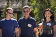 (L-R) Mark Zuckerberg, chief executive officer of Facebook, Dan Rose, vice president, partnerships at Facebook, and Sheryl Sandberg, chief operating officer of Facebook, attend the annual Allen & Company Sun Valley Conference, July 12, 2018 in Sun Valley, Idaho. Every July, some of the world's most wealthy and powerful businesspeople from the media, finance, technology and political spheres converge at the Sun Valley Resort for the exclusive weeklong conference.