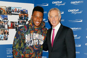 Saquon Barkley and  Tony Blair attends the Annual Charity Day hosted by Cantor Fitzgerald, BGC and GFI at Cantor Fitzgerald on September 11, 2018 in New York City.