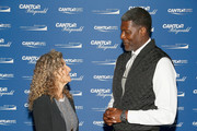 Edie Lutnick (L) and Larry Johnson  attends the Annual Charity Day hosted by Cantor Fitzgerald, BGC and GFI at Cantor Fitzgerald on September 11, 2018 in New York City.