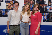(L-R) Dave Brandwood, Candice Swanepoel and Delia Burnett attend the Annual Charity Day Hosted By Cantor Fitzgerald, BGC and GFI on September 11, 2019 in New York City.