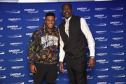 Saquon Barkley (L) and Larry Johnson  attends the Annual Charity Day hosted by Cantor Fitzgerald, BGC and GFI at Cantor Fitzgerald on September 11, 2018 in New York City.